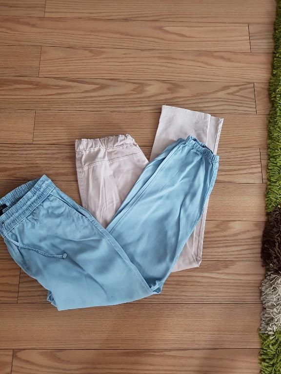 dwie pary spodni M pasują na ciążowy brzuszek